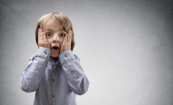 Shocked and surprised boy with copy space concept for amazement,